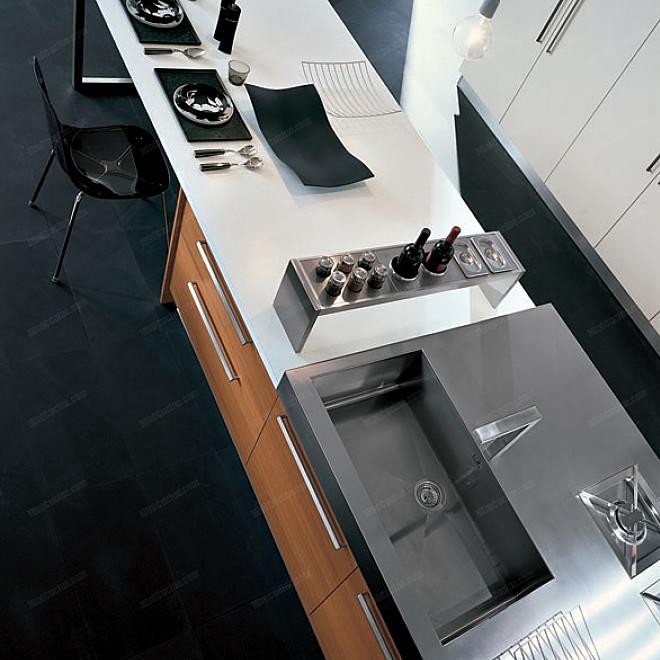 Cucina per loft con isola attrezzata for Piccoli piani cucina con isola