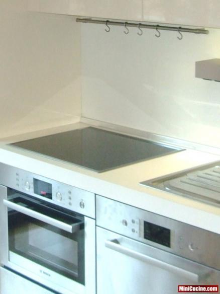 Cucina su misura a scomparsa ante a libro 9 mini cucine for Ante a serrandina su misura
